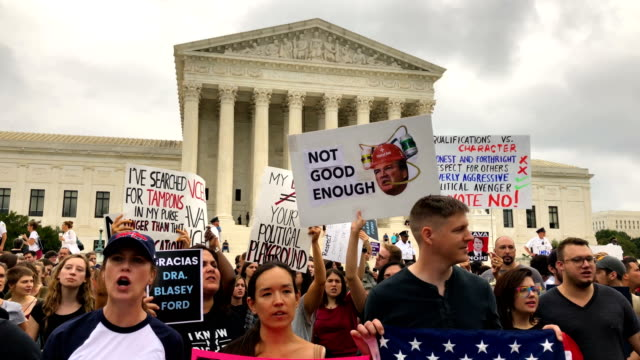 activists shout slogans during a protest against the nomination of supreme court judge brett kavanaugh to the us supreme court in front of the... - usa:s högsta domstol capitol hill bildbanksvideor och videomaterial från bakom kulisserna
