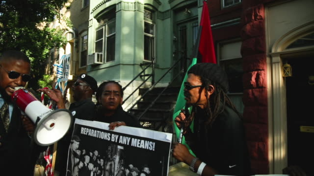 activists stage a protest to mark the national reparations day outside the residence of us senate majority leader sen mitch mcconnell july 1 2019 on... - audio electronics stock videos and b-roll footage