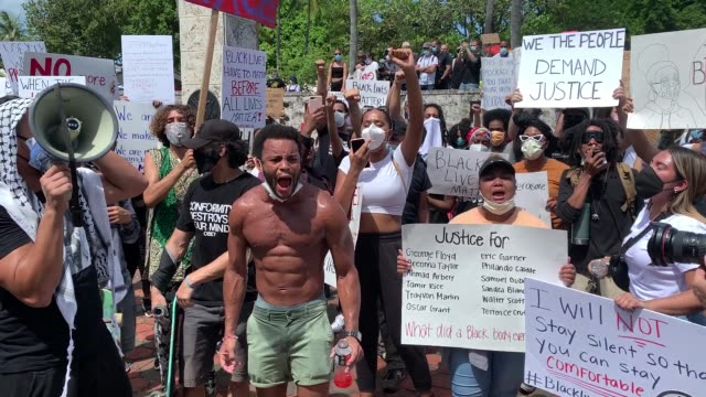 activists take to the streets in miami during a rally in response to the police killing george floyd on may 30, 2020 in miami, florida. miami joins... - miami stock videos & royalty-free footage