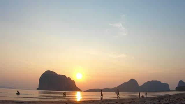 activity family on the sunset beach. - dorso umano video stock e b–roll