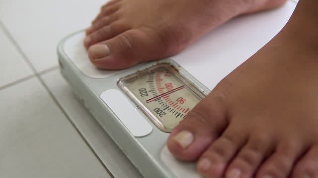 activity with leg of woman stand measuring weight scale for diet with barefoot - human limb stock videos & royalty-free footage