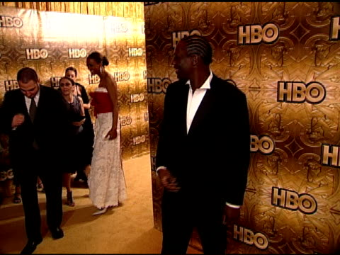 HANDHELD Actor Adewale AkinnuoyeAgbaje standing on carpet in Beverly Hilton hotel posing for photographs for press