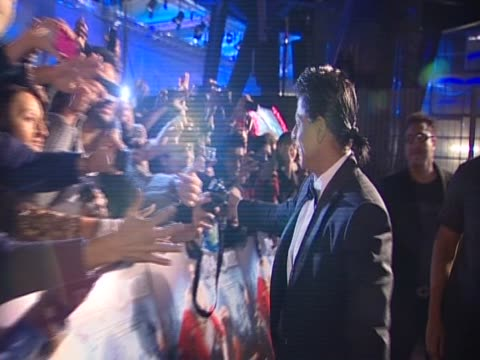 actor and producer shahrukh kan takes photos with fans in london at the premiere of the film raone - bollywood stock videos and b-roll footage