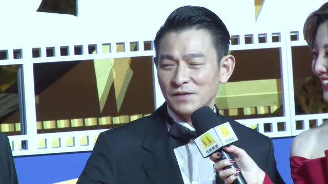 actor andy lau , actor xiao yang and director guo fan arrive at the red carpet during the closing ceremony of 33rd china film golden rooster awards... - director stock videos & royalty-free footage