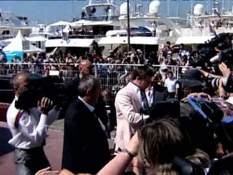 actor brad pitt signs autograph for fans at 61st cannes film festival france 14 may 2009 - brad pitt actor stock videos & royalty-free footage