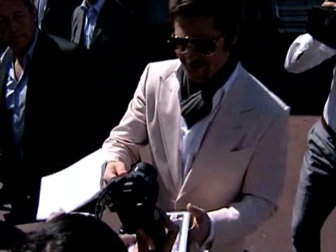Actor Brad Pitt signs autograph for fans at 61st Cannes Film Festival France 14 May 2009