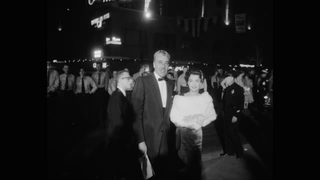 actor cesar romero arriving at premiere of giant at night los angeles california usa - mature women stock videos & royalty-free footage