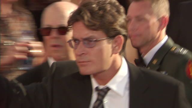 HD Actor Charlie Sheen walking through crowded red carpet outside Nokia Theatre to briefly talk to press walking back toward entrance