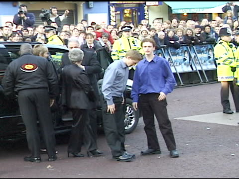 DAY HANDHELD HA Actor Chris Rankin family exiting black van at Leicester Square fans press behind barricades BG English police standing around VS...