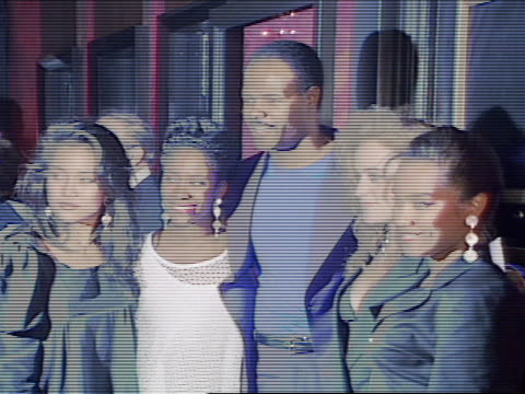 NIGHT Actor comedian Keenen Ivory Wayans posing w/ four females for photographs in theatre lobby females leaving Wayans posing alone