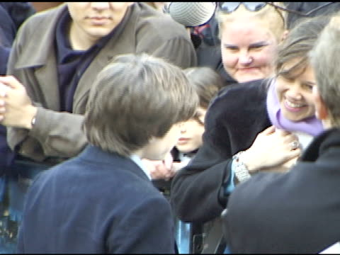 day handheld ha zi/zo actor daniel radcliffe on walkway at leicester square talking to press behind barricades - 2001 stock videos & royalty-free footage