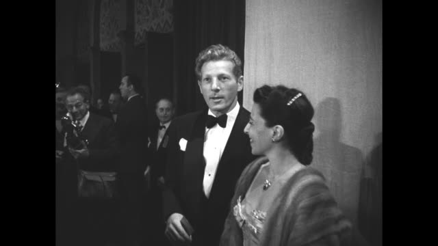 actor danny kaye and his wife, lyricist/composer sylvia fine, stand inside the shrine auditorium in los angeles as they attend the 19th academy... - composer stock videos & royalty-free footage