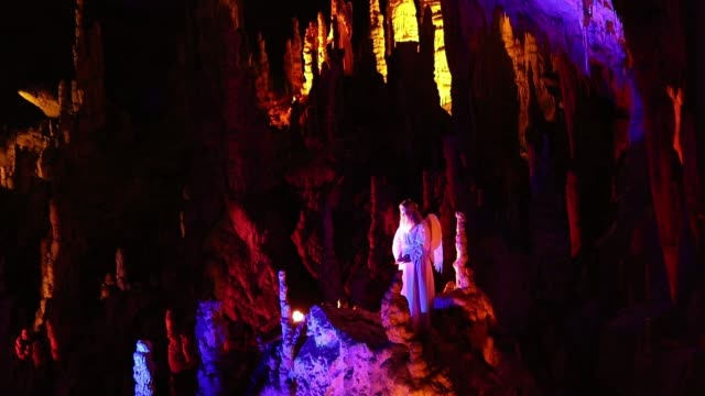 actor dressed as an angel performs live biblical scene in postojna cave on december 25 2018 in postojna slovenia the annual nativity scene is the... - december stock videos & royalty-free footage