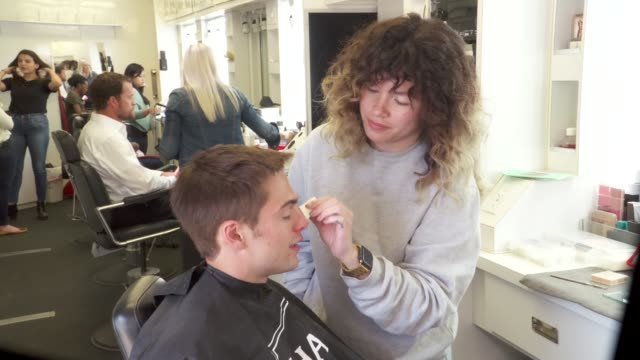 actor dylan sprayberry getting makeup for an episode of light as a feather on set visit behind the scenes at mountain view cemetery on june 19 2018... - film set stock videos & royalty-free footage