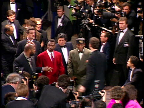 actor eddie murphy arrives with his entourage at a red carpet event - eddie murphy stock videos & royalty-free footage