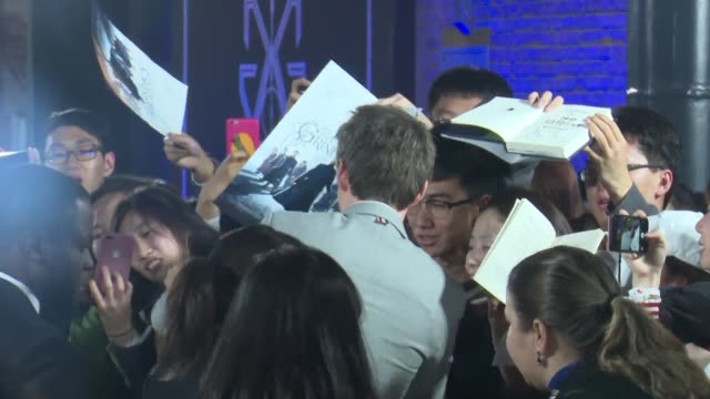 actor eddie redmayne signs for fans during 'fantastic beasts: the crimes of grindelwald' beijing premiere on october 28, 2018 in beijing, china. - film premiere stock videos & royalty-free footage