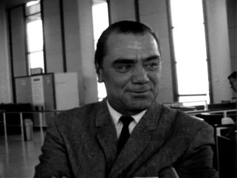 actor ernest borgnine smiling chatting with offscreen reporter while waiting in airport terminal / ethel merman getting off plane being greeted on... - fiancé stock videos and b-roll footage