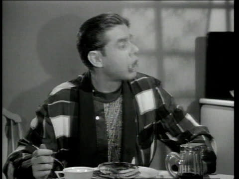 1948 montage actor george o'hanlon in the role of joe mcdoakes eating breakfast / united states - warner bros stock videos & royalty-free footage