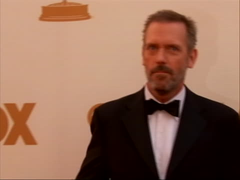 actor hugh laurie on the red carpet for 2011 emmy awards on september 18 the 63rd annual primetime emmy awards, honoring the best in primetime... - hugh laurie stock videos & royalty-free footage
