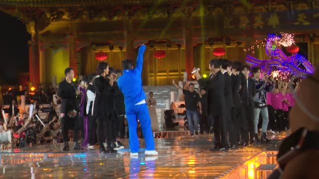 actor jackie chan performs onstage during the opening ceremony of the 4th annual international jackie chan action movie week at datong prince's... - arts culture and entertainment stock videos & royalty-free footage