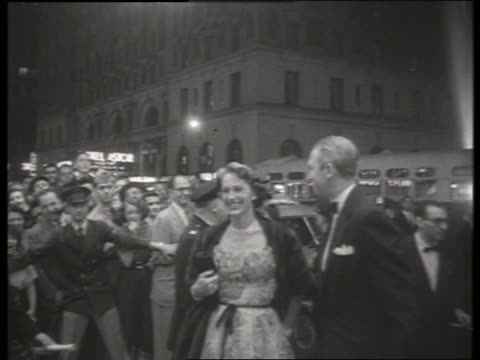 b/w 1954 actor jimmy stewart arrives at movie premiere / no sound - film premiere stock videos & royalty-free footage