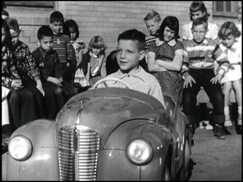 actor jimmy stewart narrates as 1954 first graders drive pedal cars on kidsized streets to learn driver safety montage first graders practice driver... - pedal stock videos & royalty-free footage