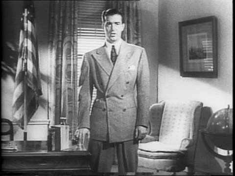Actor John Payne speaks to audience urging them to buy war bonds and stamps