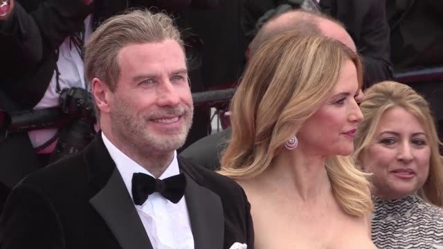 stockvideo's en b-roll-footage met us actor john travolta his family and us rapper 50 cent walk the red carpet at cannes for the european premiere of solo a star wars story - 50 cent rapper