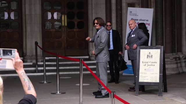 actor johnny depp arrives at the high court in london to give evidence in his libel case against the publishers of the sun and its executive editor,... - plastic bag stock videos & royalty-free footage
