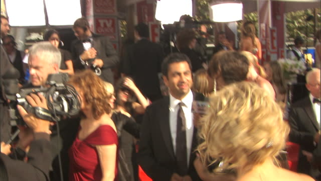 actor kal penn on crowded red carpet outside nokia theatre talking to press - emmy awards stock videos & royalty-free footage
