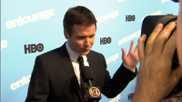 HD Actor Kevin Connolly standing on carpet outside Ziegfeld Theater talking to ET reporter press