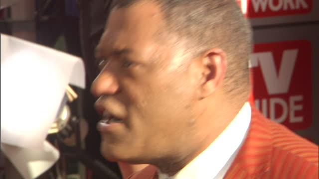 HD Actor Laurence Fishburne outside on red carpet outside Nokia Theatre talking to press