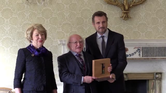 actor liam neeson is presented with the presidential distinguished service award for his contribution to the country and humanity by president... - michael d. higgins stock videos and b-roll footage