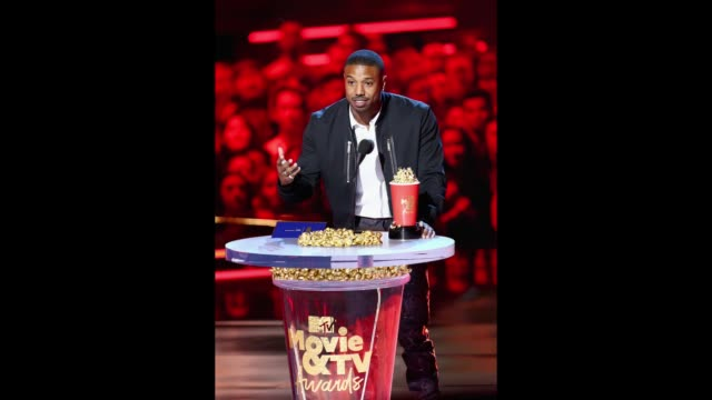 Actor Michael B Jordan accepts the Best Villain award for 'Black Panther' onstage during the 2018 MTV Movie And TV Awards at Barker Hangar on June 16...