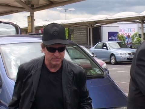 actor michael douglas arrives at heathrow with family and helps load hand luggage into waiting car before waving to cameraman - michael douglas stock videos & royalty-free footage