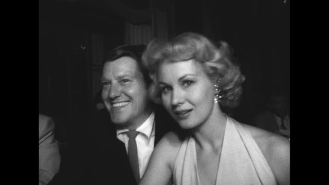 Actor Michael O'Shea and wife actress Virginia Mayo pose for camera at the victory dinner for the Hollywood Stars baseball team held at the Beverly...
