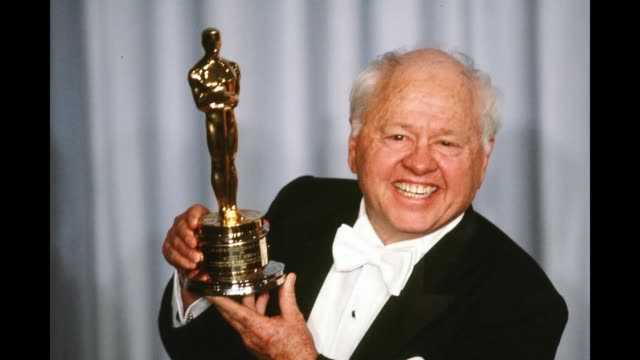 GIF Actor Mickey Rooney poses backstage after receiving 'Honorary Academy Award' during the 55th Academy Awards at Dorothy Chandler Pavilion Los...