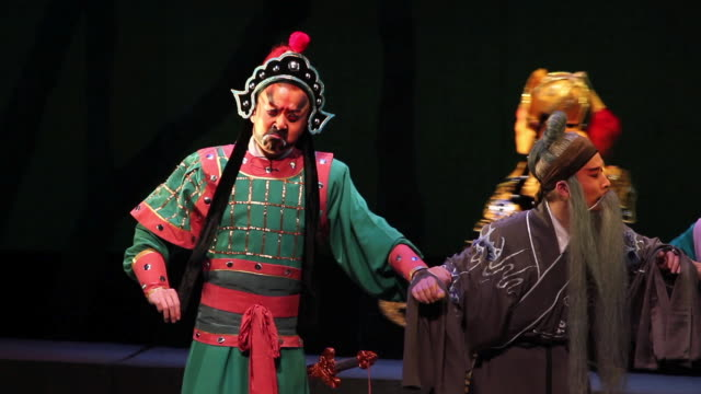 ms ts actor performing qinqiang opera in theater, qinqiang is representative folk opera of northwest china audio / xi'an, shaanxi, china - 腰に手を当てる点の映像素材/bロール
