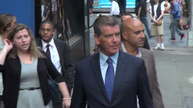 11 Actor Pierce Brosnan exits the Good Morning America show and signs for and poses for photos with fans before leaving at Celebrity Sightings in New...