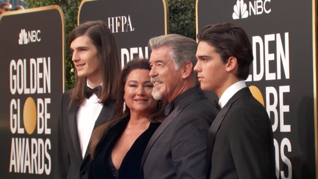 actor pierce brosnan poses with his family on the red carpet at the 2020 golden globe awards. - keely shaye smith and pierce brosnan stock videos & royalty-free footage