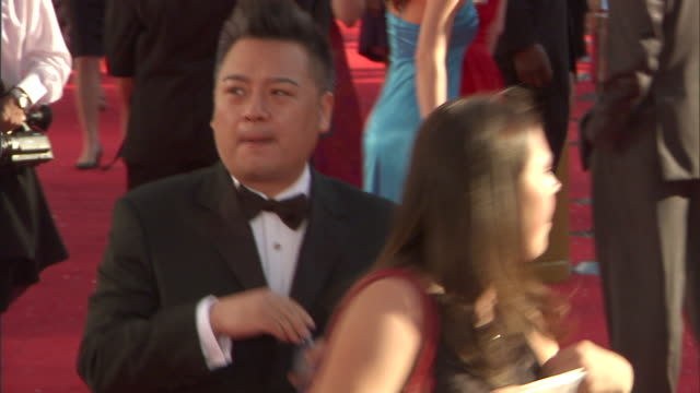 HD Actor Rex Lee walking through crowded red carpet outside Nokia Theatre drinking water