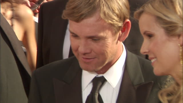 actor ricky schroder & wife & interior designer andrea bernard standing on crowded red carpet outside nokia theatre talking to press. - リック シュローダー点の映像素材/bロール