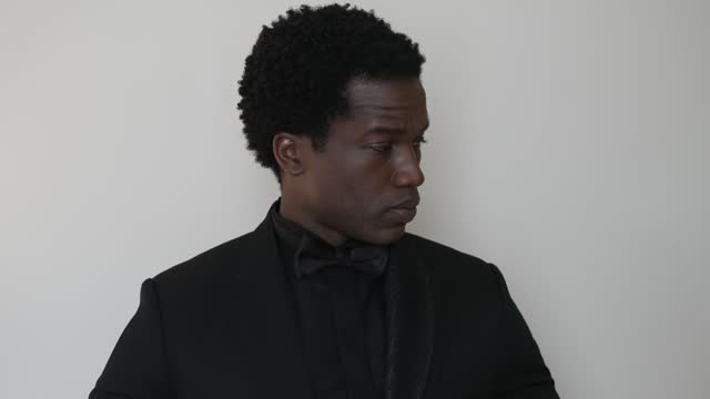 actor sope dirisu gets ready ahead of the ee british academy film awards 2021 ceremony at the corinthia hotel on april 11, 2021 in london, england.... - concepts & topics stock videos & royalty-free footage