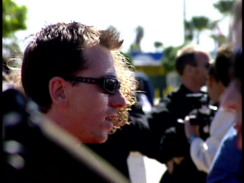 actor tim roth and his wife nikki posing for paparazzi and talking to reporters on the red carpet - tim roth stock videos and b-roll footage