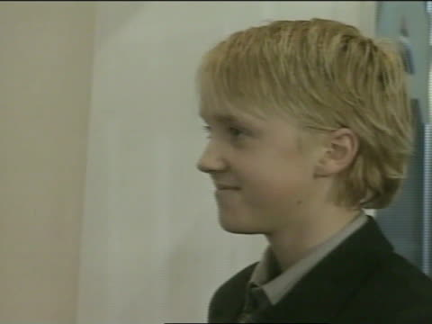 actor tom felton standing in odeon theatre entrance way, posing for press, photographs, - 2001 stock videos & royalty-free footage
