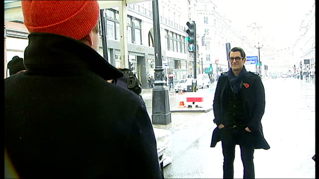 vídeos de stock, filmes e b-roll de actor ty burrell to switch on regent street christmas lights ty burrell talking to media person photographer taking picture of ty burrell various... - ty burrell