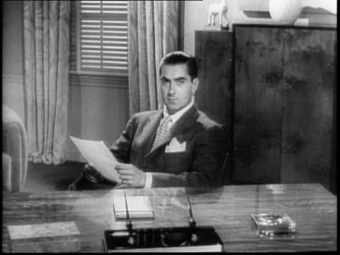 actor tyrone power at desk gets up to address the camera about purchasing war savings bonds and stamps to help fight wwii / asks the movie going... - psa stock videos & royalty-free footage