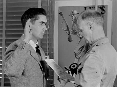 stockvideo's en b-roll-footage met actor tyrone power being sworn into marine corps actor clark gable in uniform talking w/ another serviceman world war ii - 1943