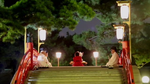 Actors are performing a traditional Japanese warrior dance in the moon ritual of Sumiyoshi Taisha Every midautumn the festival is held with a...