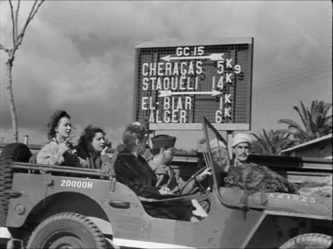 Actors Carole Landis Kay Francis Martha Raye in Jeep in North Africa Kay Francis Carole Landis Martha Raye standing w/ soldiers in chow line Martha...